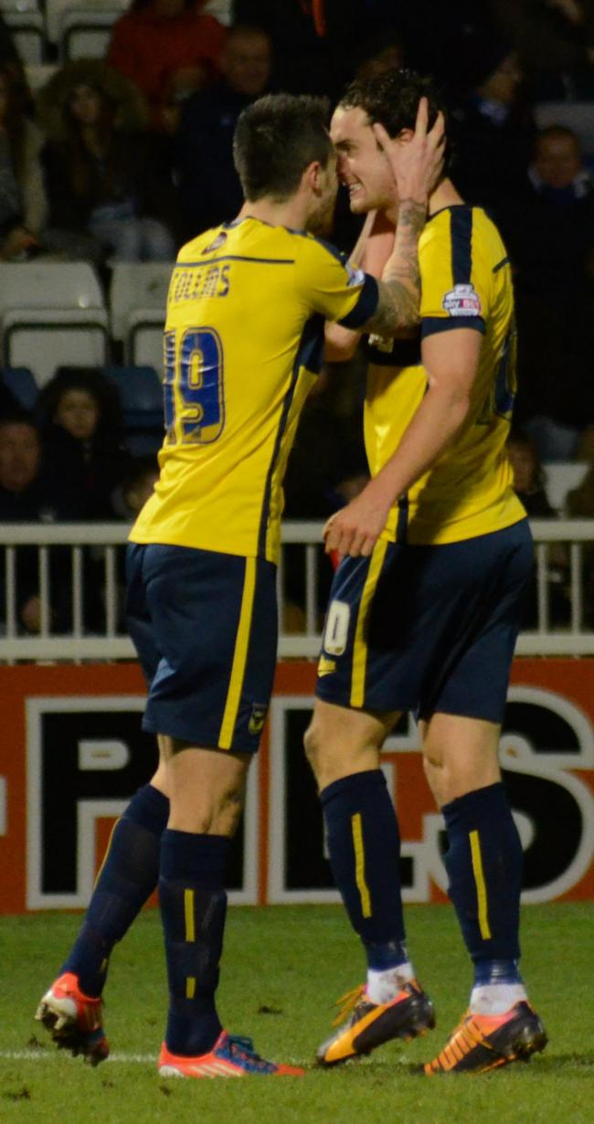 Michael Collins congratulates Danny Hylton on his equaliser