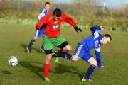 Carterton Town A's Tomas Bezdecny (left) tackles West Witney's Will Smalldon