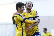 Danny Hylton (right) celebrates with Josh Ashby after scoring against Exeter last weekend