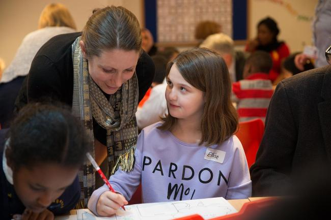 Ellise Watson, 11, with mentor Christine Moor at the launch of the new learning centre