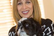 Relationship coach and author Annie Kaszina with her dog Basil