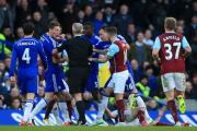 Chelsea's Nemanja Matic (second left) reacts following a foul by Burnley's Ashley Barnes (grounded) in the 1-1 draw at Stamford Bridge last Saturday, for which the Blues man was dismissed