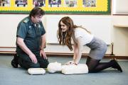 South Central Ambulance Service's Dick Tracey teaches Sophie Roger, 17, how to use a defibrillator at Chipping Norton School