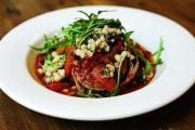 Chef's Special recipe - Braised local lamb belly stuffed with black pudding and a white bean, mint and rocket salad