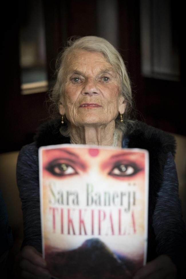 Sara Banerji holding her latest novel Tikkipala