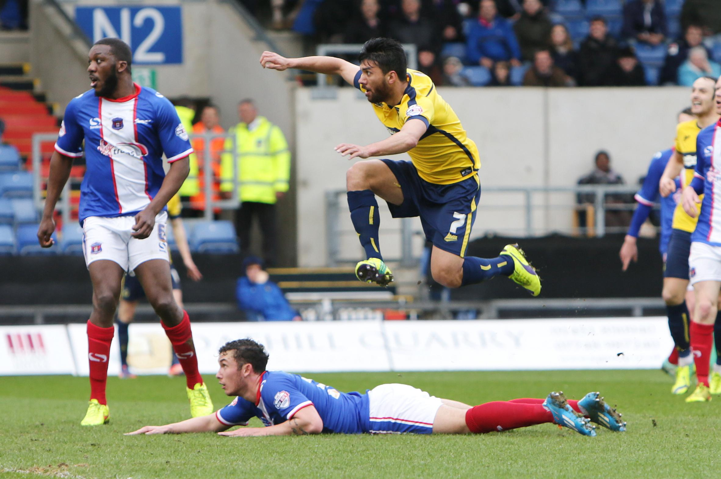 Oxford United midfielder Danny Rose is airborne as he fires in a shot which hits the underside of the bar and bounces clear to safety