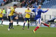 George Baldock goes for goal in Saturday's massive win for Oxford United against Carlisle United