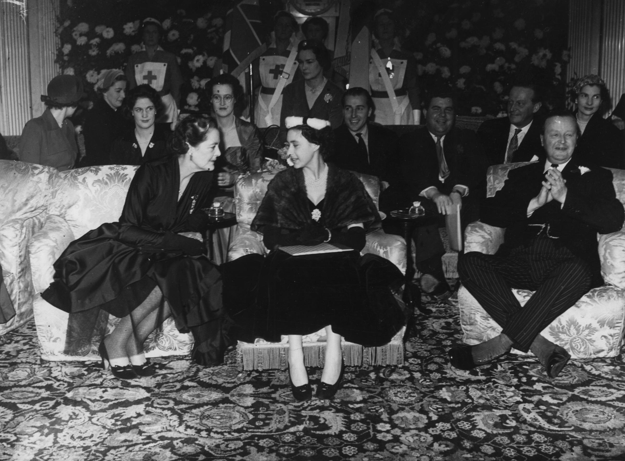 Front-row seat: Princess Margaret with the Duke and Duchess of Marlborough at the Christian Dior fashion show held at Blenheim