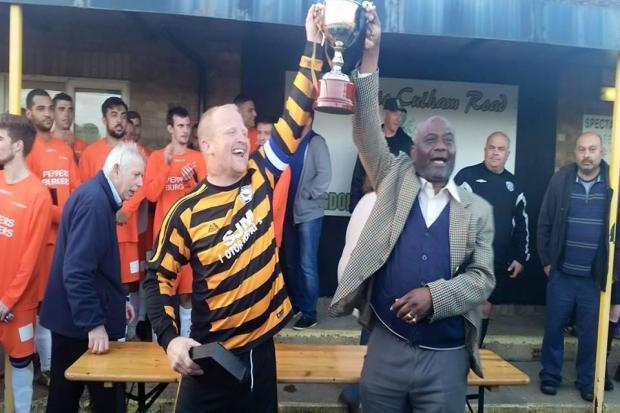 Team manager of The Blackbird, Stuart Parsons (left) and the pub's landlord Glen Williams with the Devenney Cup