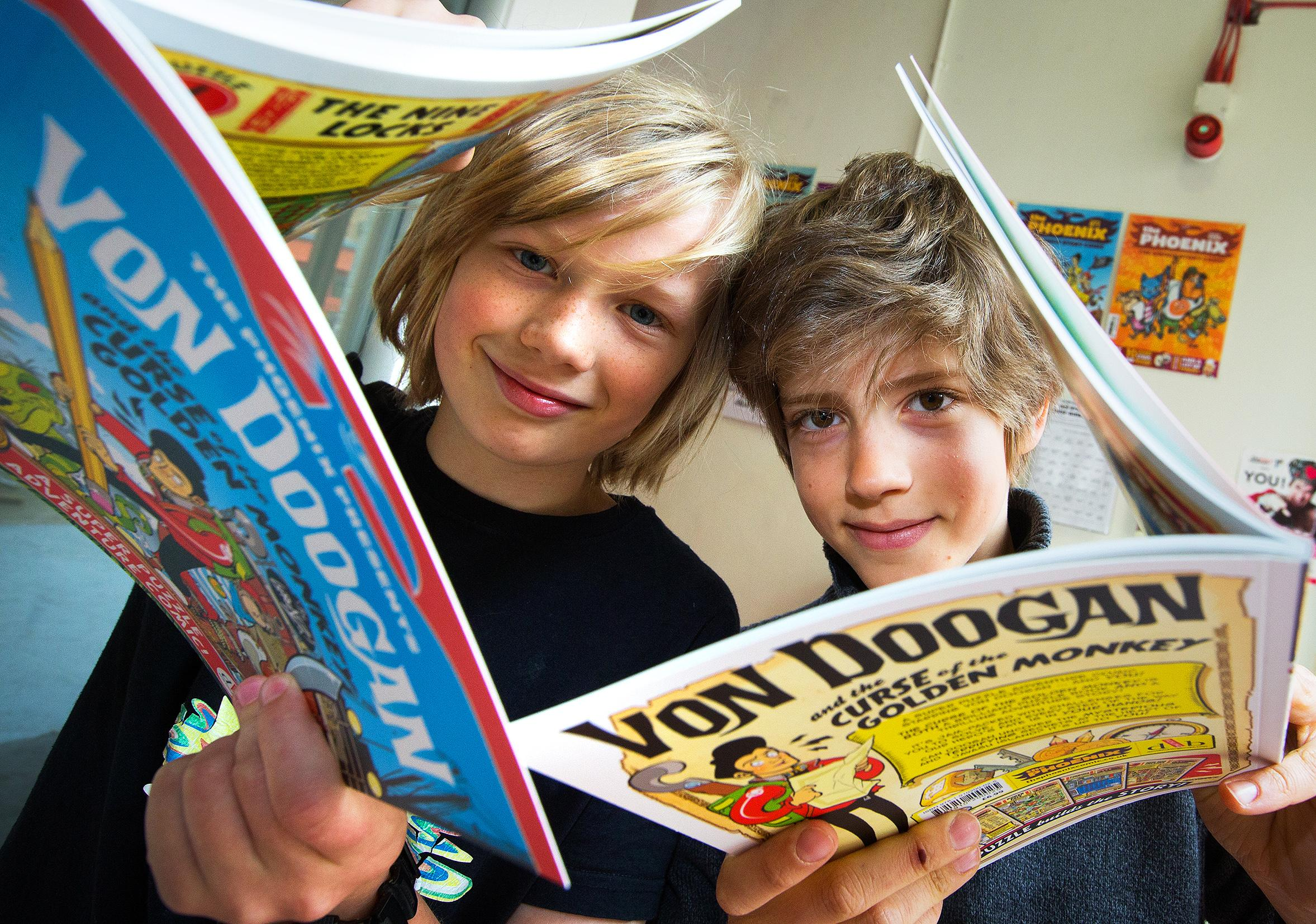 Keen: Alex Turner, 11, left, and Jules Reuter, 10, with their comics at the Story Museum event