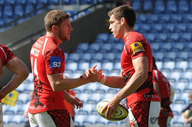 Chris Elder (right) is congratulated by Alan Awcock after scoring and converting a try