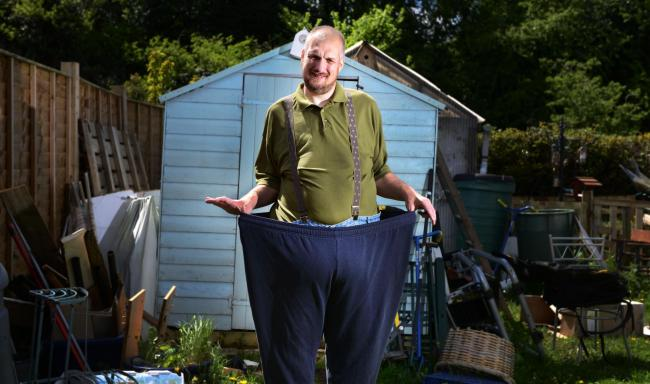 Transformed: James Bond, who has lost 24 stone in just over a year, pictured with his old trousers