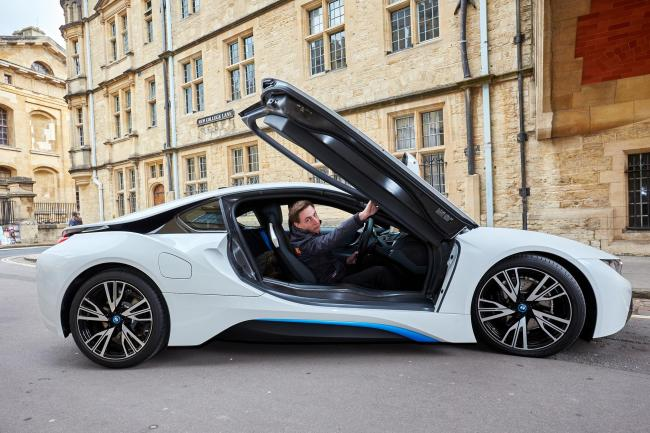 Going places: Pete Hughes behind the wheel of a £100,000 BMW i8 hybrid sports car near the Bridge of Sighs