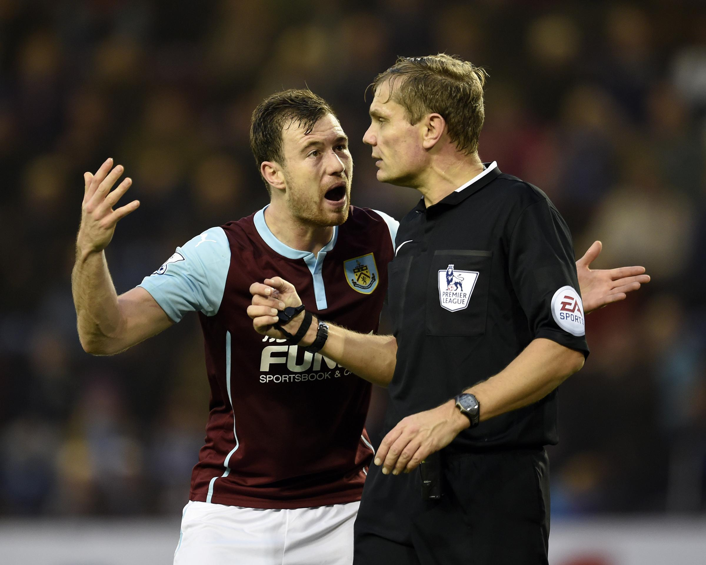 Burnley's Ashley Barnes argues with referee Graham Scott after being shown a yellow card in the game against Aston Villa last season. The match was Scott's first in the top flight