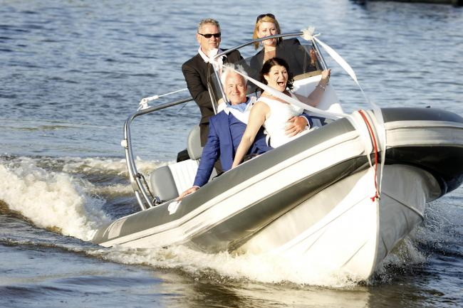 Nuptials: Russ Hannan and Claire Wilson travel by boat to get to their reception