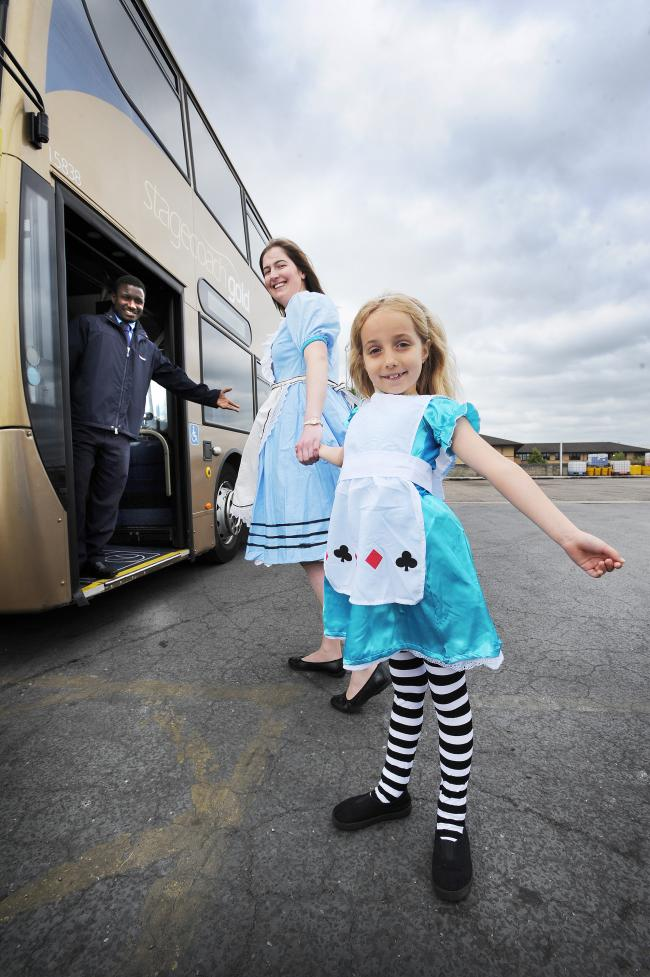 Linking up: Stagecoach is offering free travel to anyone dressed as Alice on Alice's Day. Pictured are driver Lamarana Bah, with Michelle Mansell, eight, from East Oxford Primary School, and Emma Wilberforce from Stagecoach