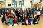 Hands up: Centre, from left, Kate Berman, Windmill Primary School headteacher Lynn Knapp and Jayne Lacny