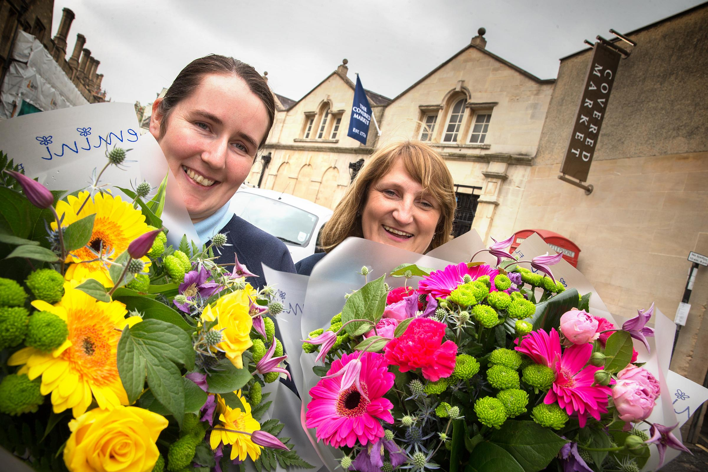 Blooming: Samantha Turner, left, and Elizabeth Pinker, from Jemini Flowers, look forward to the outdoor market