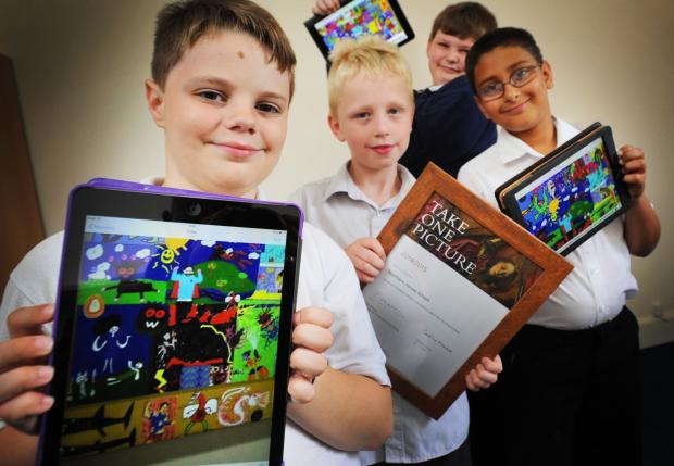 Creative: From left, pupils Owen Mitchell, nine, Trea Catling, nine, Harry Read-Strahan, 11, and Amaan Qume, nine