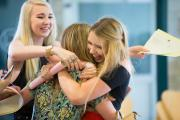 Celebration time: The scene at Wood Green School, Witney, on A-Level day last year as Molly Howlett, left, and Megan Prosser, right, congratulate Becky Brooks