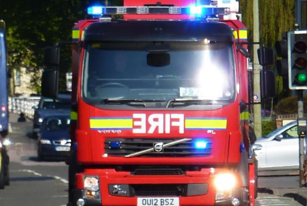 Woman stuck in mud up to her chest rescued by fire crews