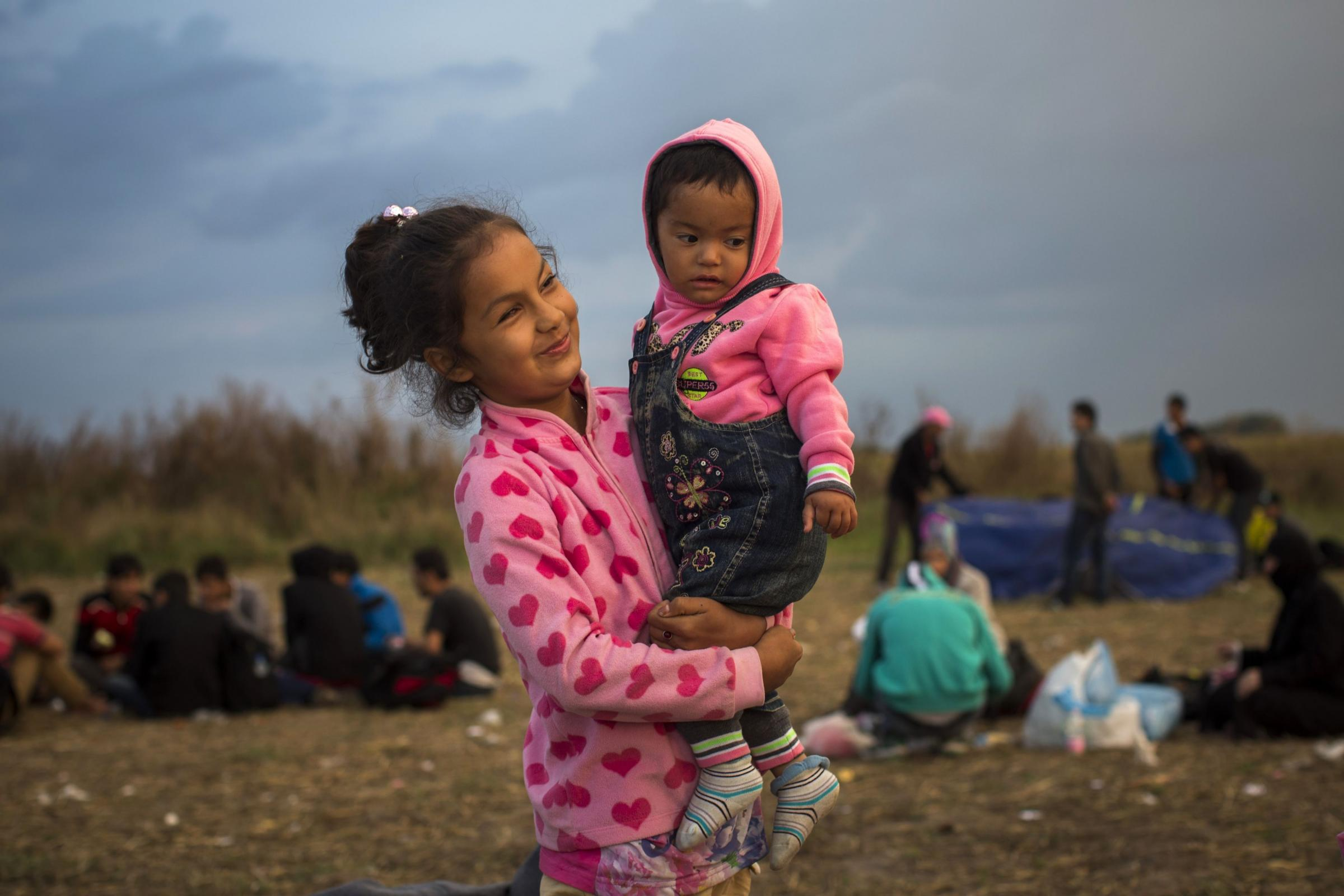 Seeking help: Afghan girls wait at a checkpoint near the Hungarian town of Roszke yesterday after crossing the border from Serbia
