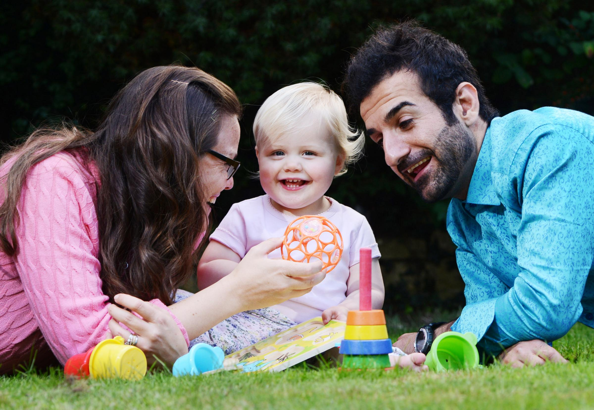 Happy families: Nicola Smith and her daughter Jodi with Peyman Ismaeli at home in Barton