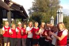 The Oxford Ladies squad toast their success (from left): Jane Tavinor, Ruth Stockford, Pat Smith, Maggie Edwards, Hil Pennick, Jan Glover, Maggie Findlay, Tracy Roberts, Judy McCairns, Dee Chappelle, Rosie Caunt