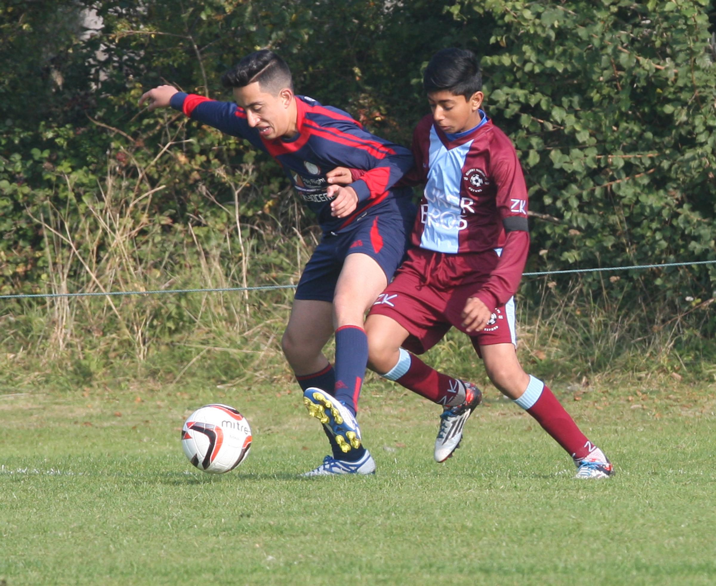Marston Saints' Dylan Thagie holds Quarry Rovers' Umair Yousef at bay during the 1-1 draw at Marston in the Under 15 C League           Picture: Steve Wheeler