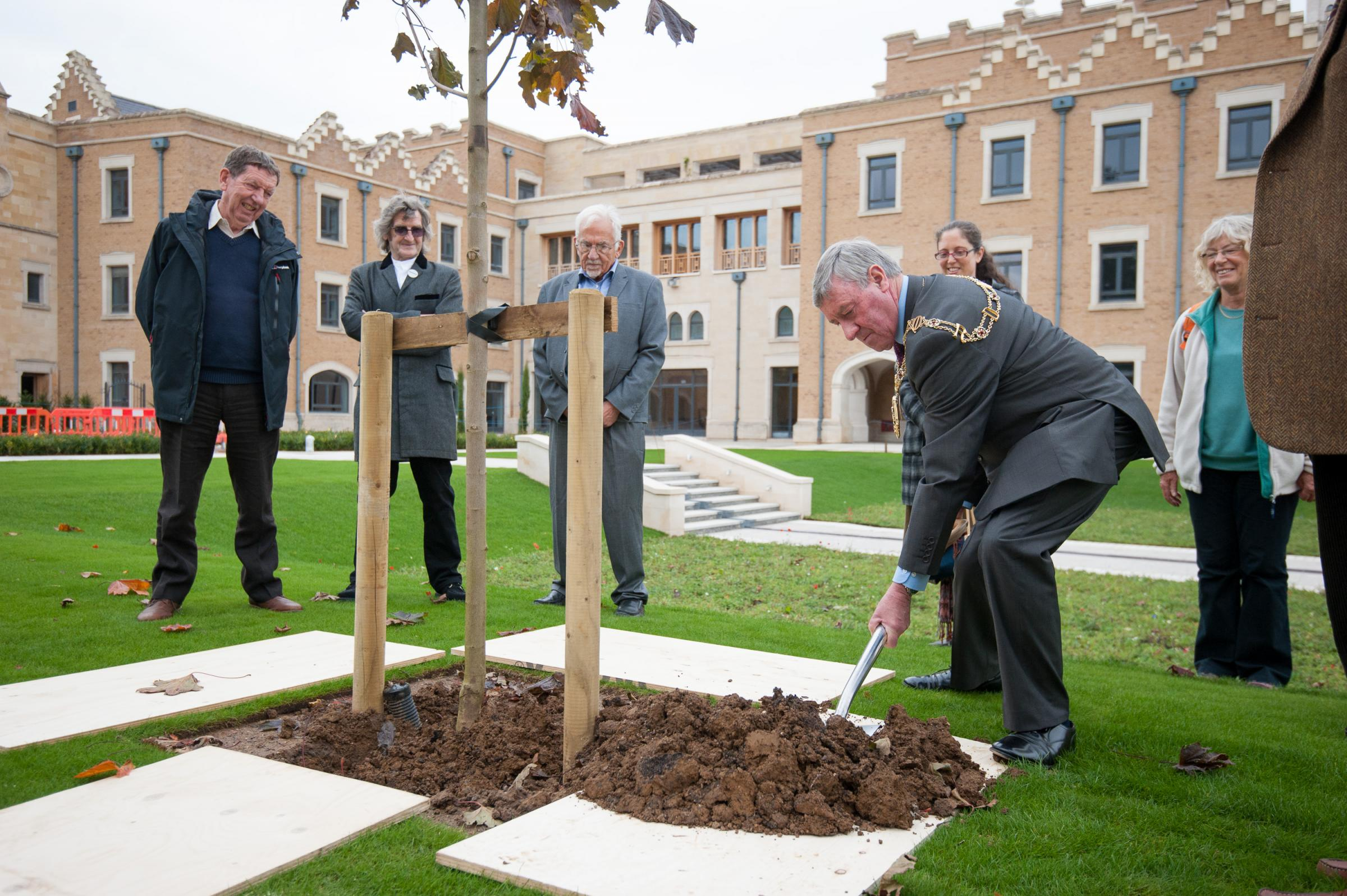 New life: Lord Mayor of Oxford Rae Humberstone plants a tree in the Prince of Wales Garden at the Oxford Centre for Islamic Studies before being given a tour of the building