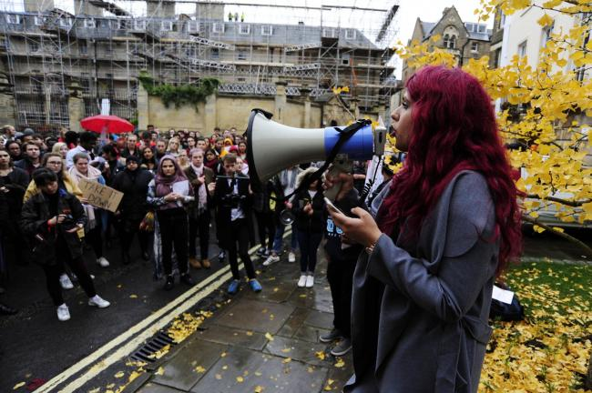 Protest: Kiran Benipal speaks to the gathered students in Oriel Square