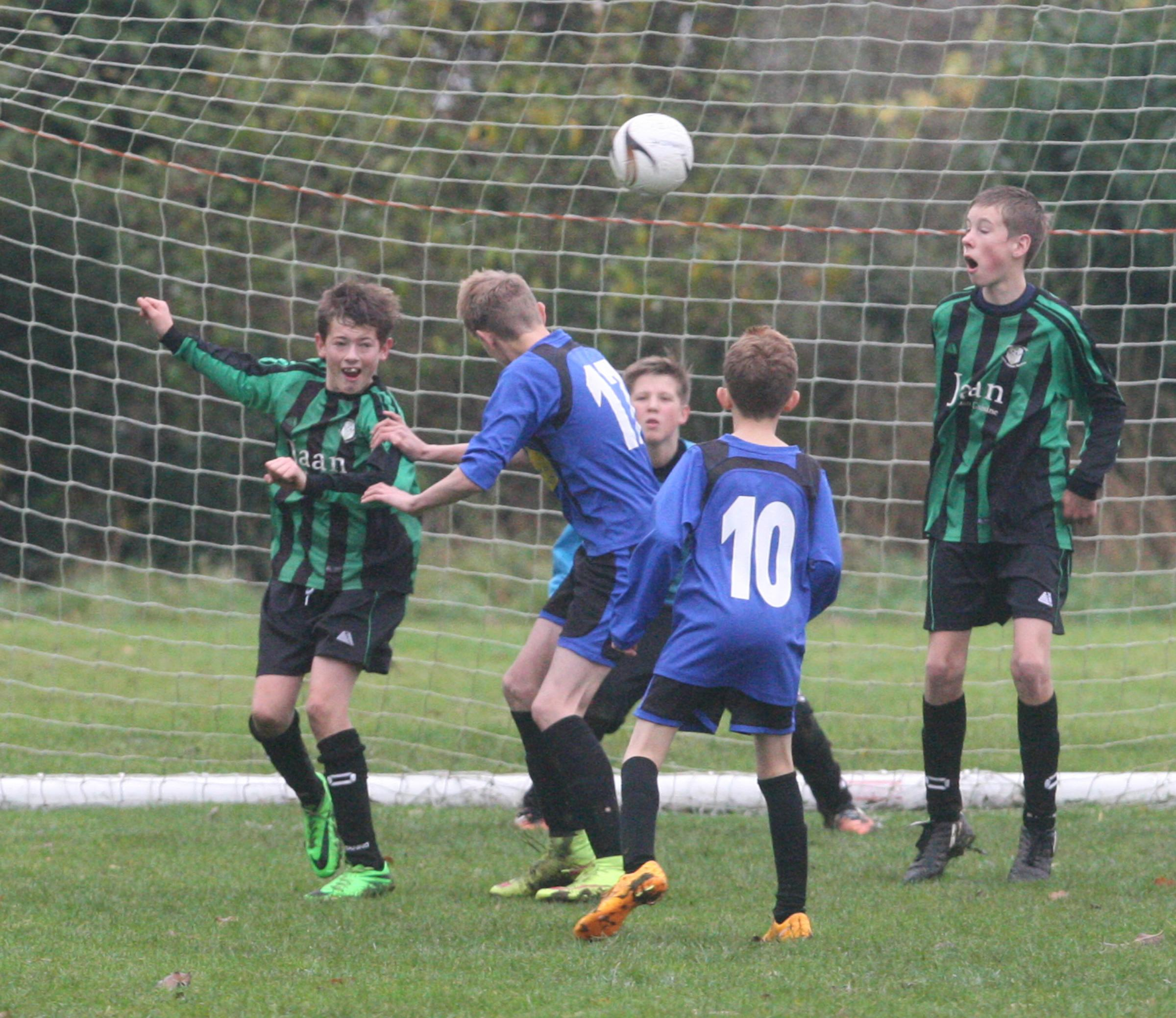 Cumnor's Matthew Davies (No 17) goes close to scoring with a header in his team's exciting 4-3 win over Combe in the Under 13 B League