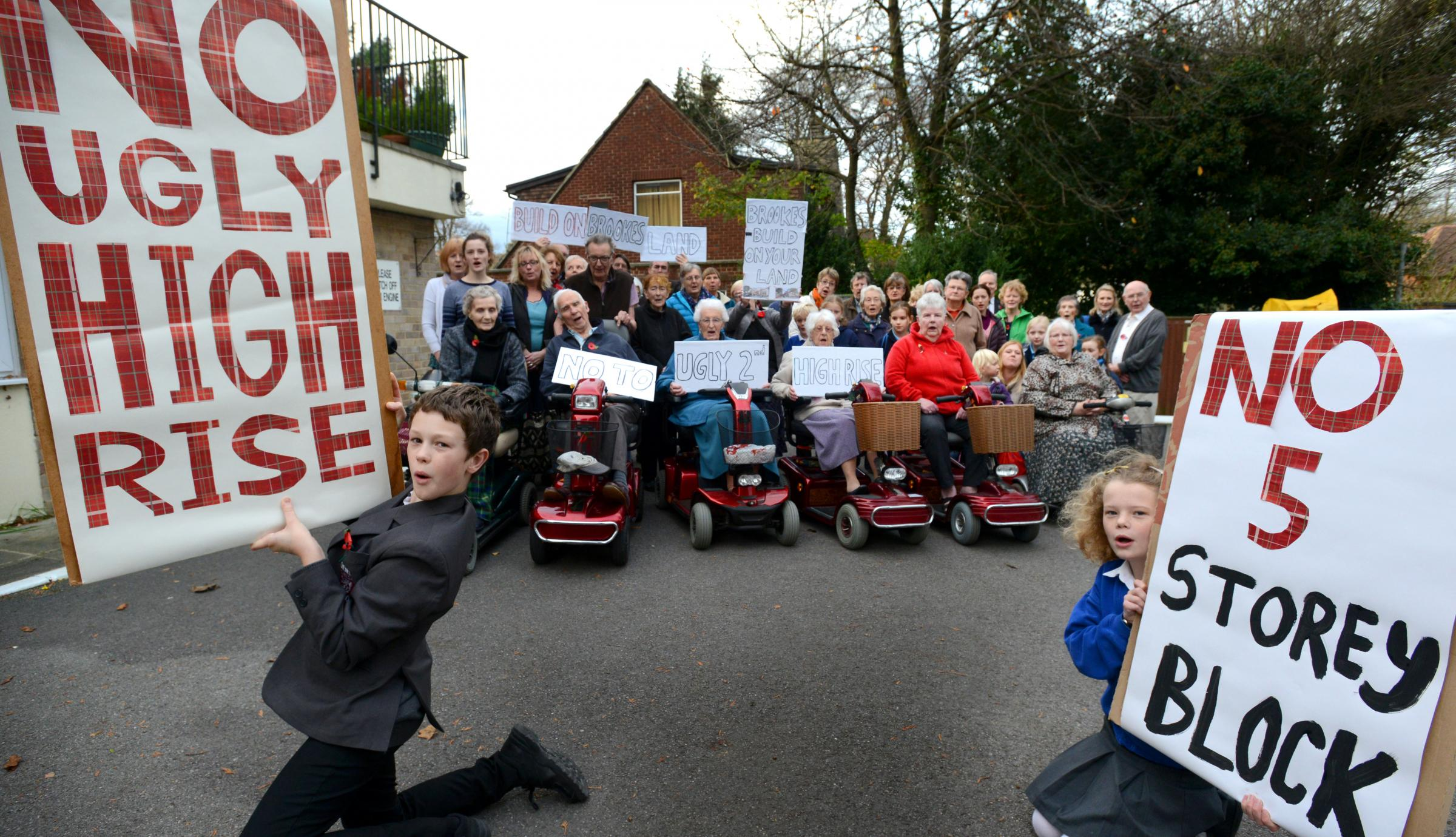 Residents, schoolchildren and those in sheltered accommodation at McMaster House are against plans for a five-storey development for 167 students, below. Among those holding placards are Joseph Rea, 11, left, and Rachel Goodrich Jones, 10, right