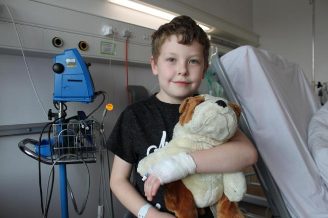 Lifesaving treatment: Lucas Cox, eight, was rushed to hospital at just nine days old for surgery on a deformed valve in his heart and is now fitted with a pacemaker