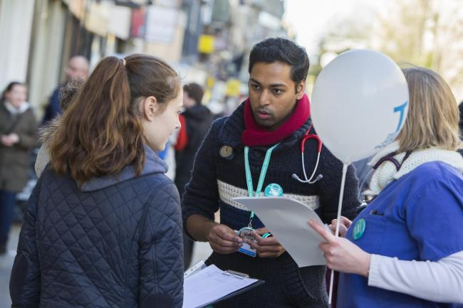 Call for support: Junior doctor Karthick Darma speaks to shoppers about planned industrial action and reasons for striking in Oxford last month