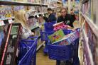 Bargain hunting: Cousins Stacy Levine, left, and Melissa Bragg shop at the Toys R Us store in Atlanta on Black Friday