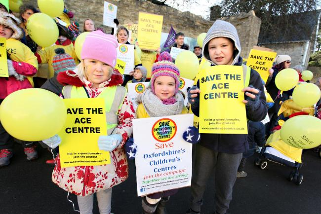 Campaign: Lizzie Motley and Honour Nolan, both four, and Sandy Motley, seven, join the demonstration outside Ace Children's Centre in Chipping Norton last month