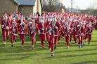 The field of about 470 competitors start the Santa Fun Fun in Pingle Field, Bicester  Picture: Damian Halliwell