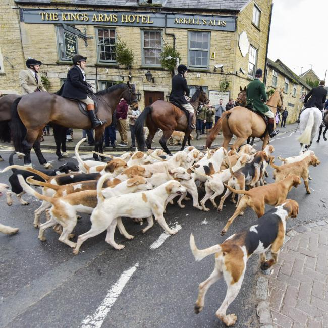 The Heythrop Hunt moves off from the Fox pub in Chipping Norton after its Boxing Day meet