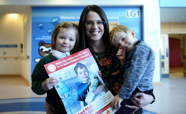 Eve Hanlon has again signed up for the OX5 Run to say thanks for the treatment her daughter Martha received in her battle against leukaemia. Also pictured is Martha's brother Patrick