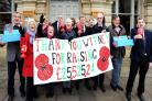 Members of the Witney and District Royal British Legion hold a giant banner celebrating the impressive haul of money raised in the town between November 2014 and November 2015