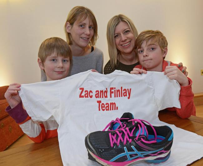Tabitha Durkin with her son Zac, seven, who is receiving treatment for leukaemia, and Suzanne White with her son Finlay, 11, who has recovered from bone cancer