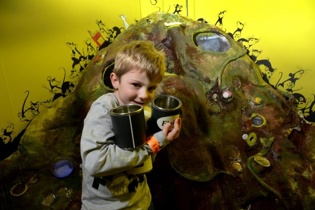 "James Fraser, five, from Abingdon, explores the ""rubbish dump"" at The Story Museum, Oxford."