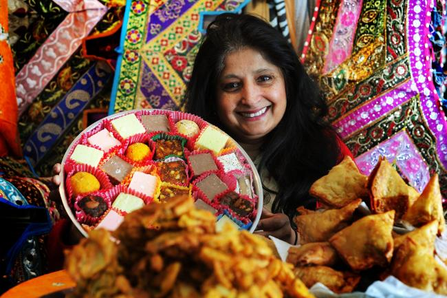 Jaya Patel with some of her homemade bhajis, pakoras and sweets