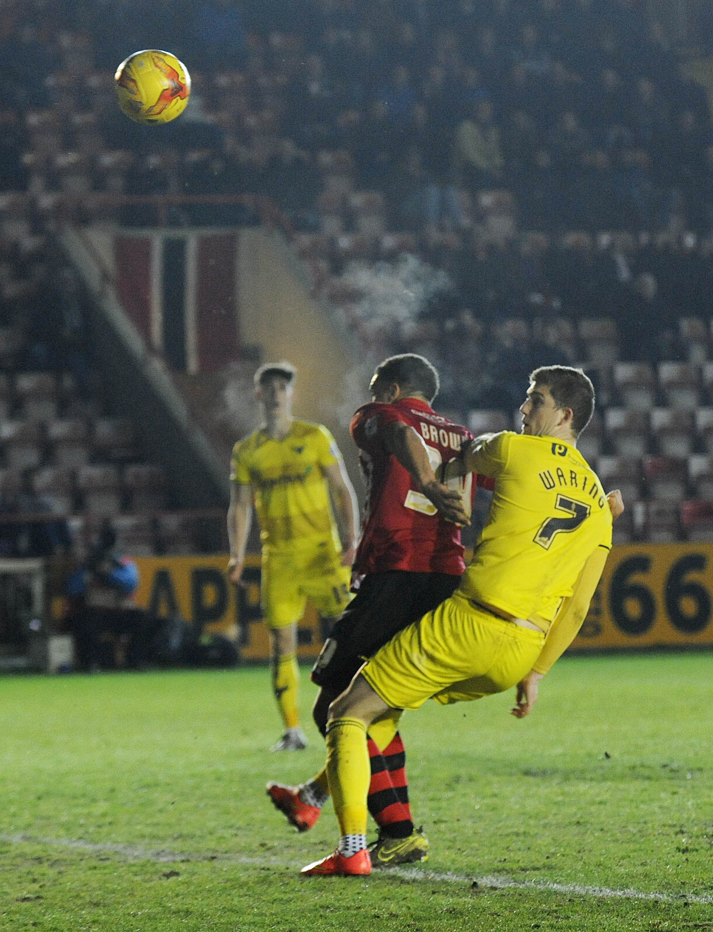 George Waring heads against the bar after coming off the bench during Oxford United's win against Exeter on Tuesday