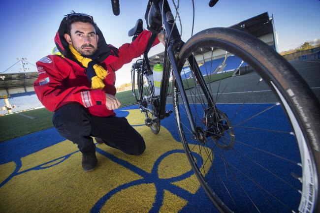 Loyal Oxford United fan Simon Parker who is embarking on a sailing and cycling trip around the world