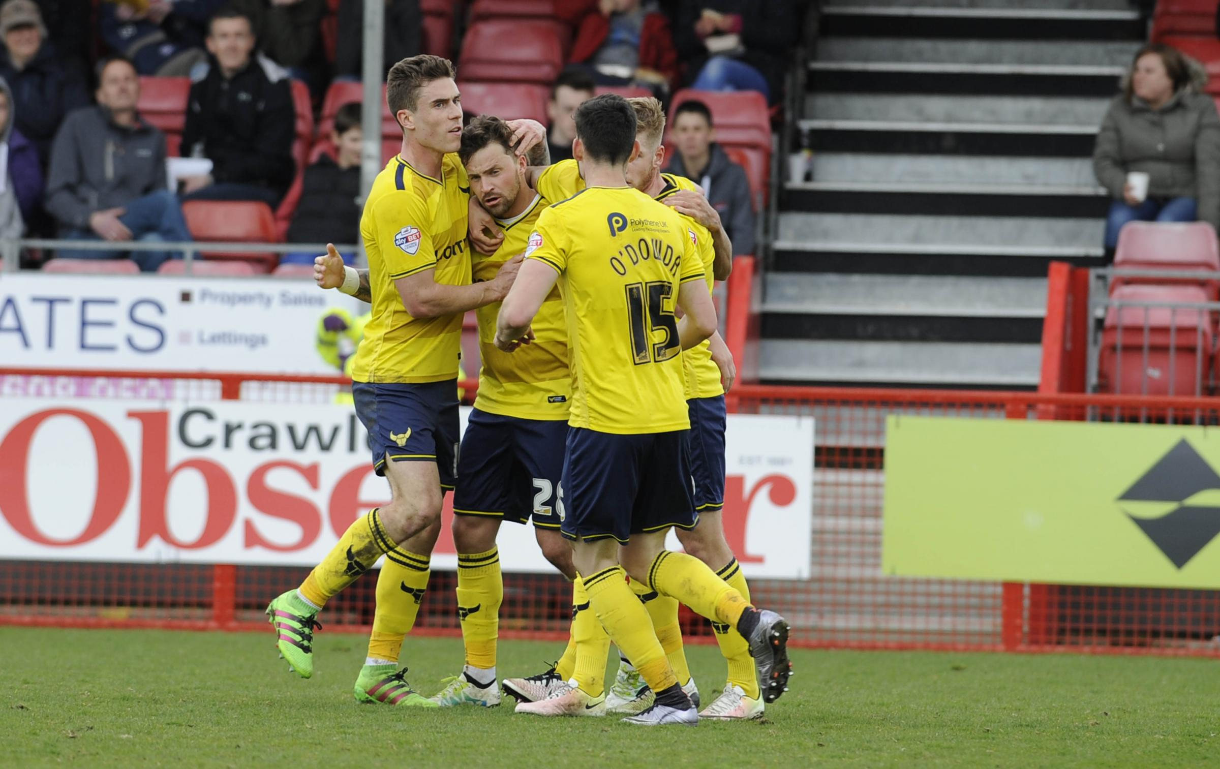 Chris Maguire is mobbed after scoring Oxford United's equaliser  Picture; David Fleming