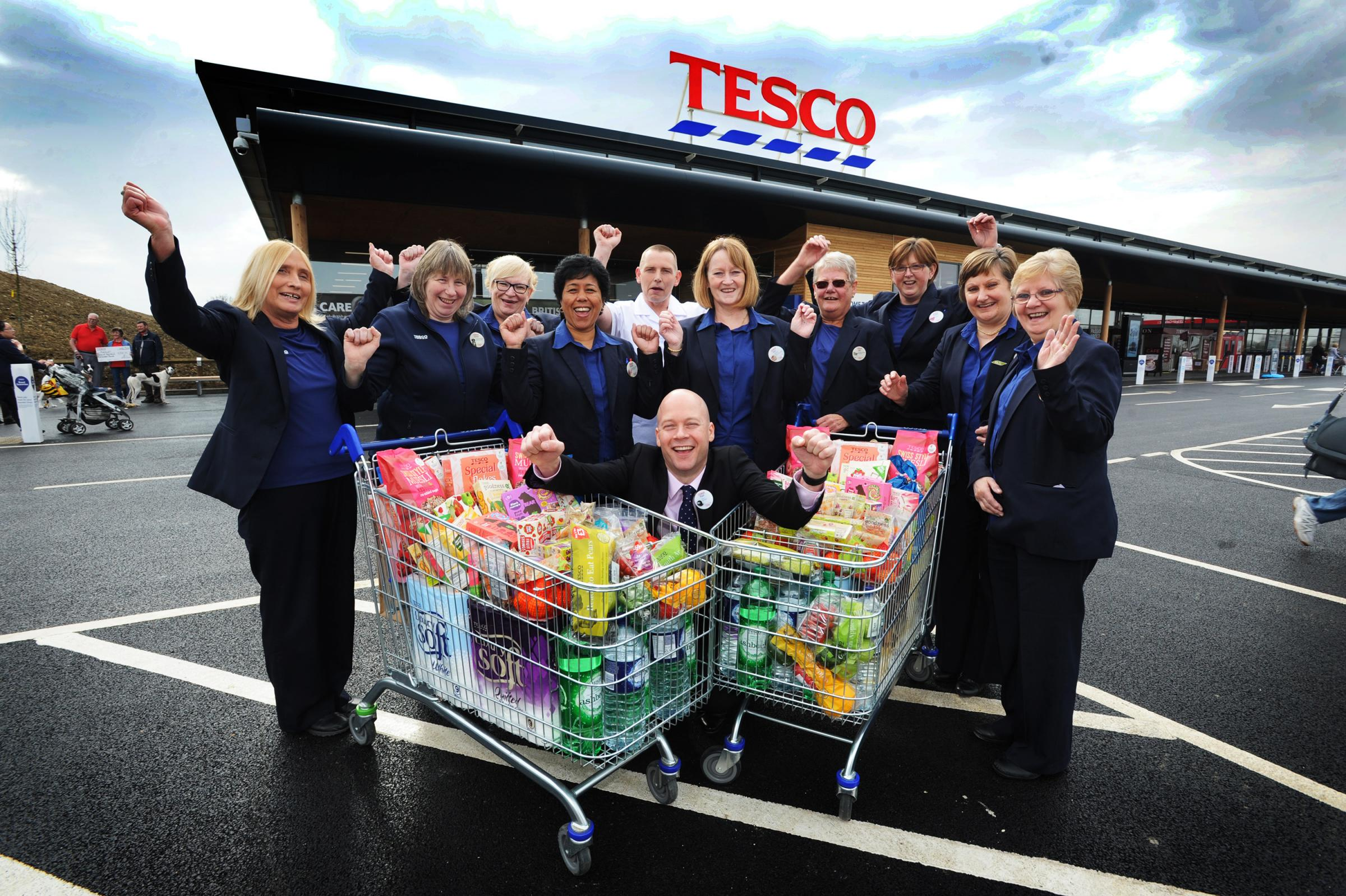 The official opening of Bicester's new Tesco superstore on April 14, 2016. Store manager Paul Phillips is pictured with long-serving staff members, L to R, Kathy Chester, Jackie Gibson, Ann Smith, Esther Boyce, Paul Upstone, Sue Smith, Gill Collings, Debb