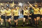 Oxford United parade the Milk Cup round Wembley after beating QPR 3-0 in the final