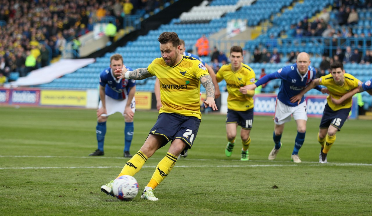 Chris Maguire opens the scoring for Oxford United from the penalty spot  Pictures: Richard Parkes